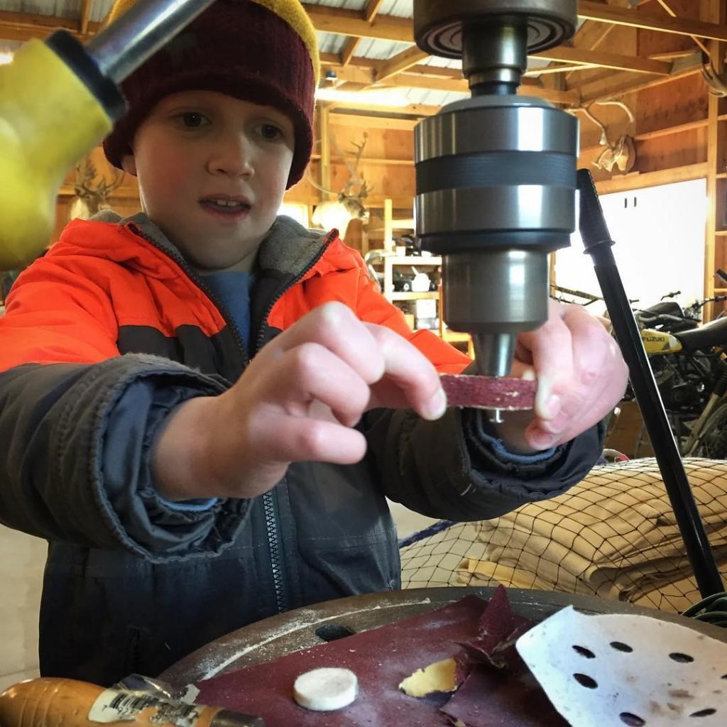 Cooper sanding the axles